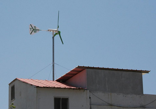 Roof leading residential wind turbine