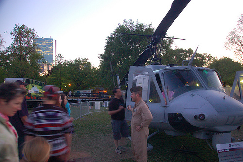Marine Week Boston, 2010: Bell UH-1N Huey helicopter getting viewed by civilians & soldiers at dusk